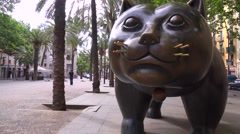 A large sculpture of a cat sits along a street in Barcelona, Spain. Stock Footage