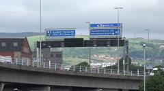 Traffic crosses lagan bridge over lagan river, belfast, northern ireland Stock Footage