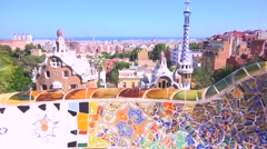 The bright and colorful artwork of Gaudi in Park Guell, Barcelona, Spain. - stock footage