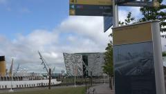 Tourist sign posts at titanic belfast visitor centre, northern ireland Stock Footage