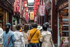 people walking in street of fang bang zhong lu old city shanghai china - stock photo