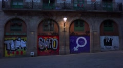 Graffiti on doors at night in Barcelona, Spain. Stock Footage
