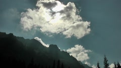 Large white cloud and mountains Stock Footage