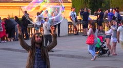 A performance artist makes large bubbles in Barcelona, Spain. Stock Footage