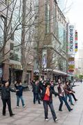 People exercising on nanjing road shanghai china Stock Photos