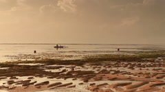 Fisherman and child floating on Jukung boat Stock Footage