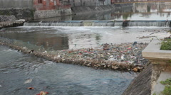 Jammed garbage in the river network in Denpasar Stock Footage