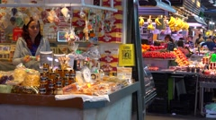 Vendors sell their goods in an indoor market in Barcelona, Spain. Stock Footage