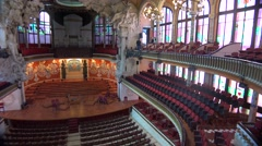 Pan across a beautiful performing arts hall in Barcelona, Spain. - stock footage