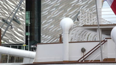 Titanic belfast visitor centre and ss nomadic boat, northern ireland Stock Footage