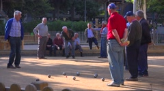 Retired men play a game of bowls in Barcelona, Spain. Stock Footage