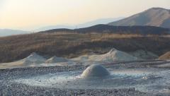 Stock Video Footage of Visiting Mud, Muddy Volcanoes in Sunset, Landmark, Reservation, Tourism, View