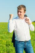 Wealthy businessman expresses his feelings with gestures Stock Photos
