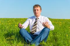 businessman relaxing relieves stress in the field - stock photo