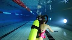 Female scuba diver underwater Stock Footage