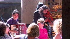 Street musicians perform at a Barcelona restaurant. Stock Footage
