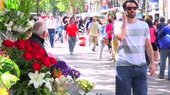 Crowds walk in a neighborhood in Barcelona, Spain. Stock Footage