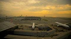 Stock Video Footage of Time lapse Hong Kong International Airport sunset aircraft transportation China