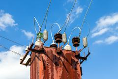 power transformer against the blue sky background - stock photo