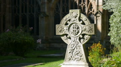 Celtic Christian cross in a churchyard. Stock Footage