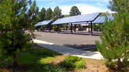 Stock Video Footage of Solar Panels In Business Parking Lot- Wide
