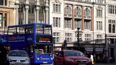 Red London busses and Black Cabs in traffic in London. - stock footage