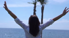 Woman rising hands and feeling free, slow motion shot at 240fps - stock footage