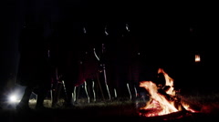 Masai Standing Around a Bonfire Stock Footage
