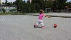 Child playing with red ball. Kid taken the ball with hand and run. Slow motion. - stock footage