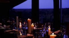 Beautiful Dinner Table Setup with Candles Stock Footage