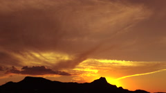 Glorious Sunset Glows Over Silhouetted Mountains Time Lapse Stock Footage