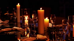 Beautiful Dinner Table Setup with Candles - stock footage