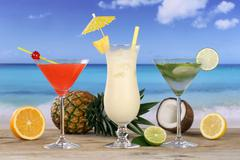 cocktails and drinks on the beach and sea - stock photo