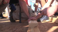 habitat home building hammering low angle - stock footage