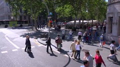 High angle over a Barcelona, Spain intersection with pedestrians crossing Stock Footage