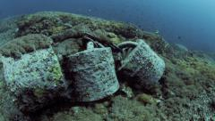 Concrete anchor blocks on ocean floor Stock Footage