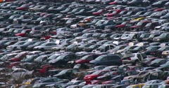 Cars sit in rows in a junkyard in the snow. Stock Footage