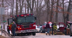 Firemen administer at an accident scene. Stock Footage