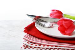 Dishware with red tulips Stock Photos