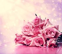 Beautiful pink roses on pink wooden table Stock Photos