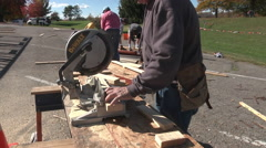 Habitat home building zoomin table saw Stock Footage