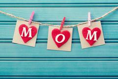 Mothers day message on felt hearts Stock Photos