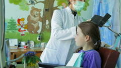 Dentist Fitting Braces In Girl's Mouth Stock Footage