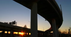 The arc of a freeway overpass at sunset. Stock Footage