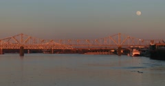 Bridges span the Ohio River near Louisville, Kentucky at dusk. Stock Footage