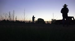 COWBOY RANCHER, silhouette shaking hands Arkistovideo