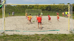 Time lapse soccer football kids playing game in the sand ,kids enjoy in sport Stock Footage