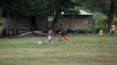 Boys playing game of social football Stock Footage