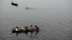 Boys having fun in wooden canoe - stock footage