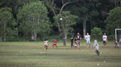 Visiting and locals playing social game of football Stock Footage